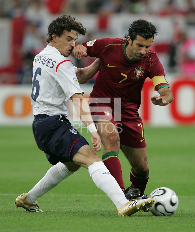 Portuguese forward (7) Luis Figo fights for the ball with English midfielder (16) Owen Hargreaves.  Portugal defeated England on penalty kicks after playing to a 0-0 tie in regulation in their FIFA World Cup quarterfinal match at FIFA World Cup Stadium in Gelsenkirchen, Germany, July 1, 2006.