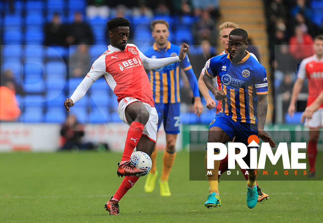 Jordy Hiwula of Fleetwood Town wins the ball against Abu Ogogo of Shrewsbury Town during the Sky Bet League 1 match between Shrewsbury Town and Fleetwood Town at Greenhous Meadow, Shrewsbury, England on 21 October 2017. Photo by Leila Coker / PRiME Media Images.
