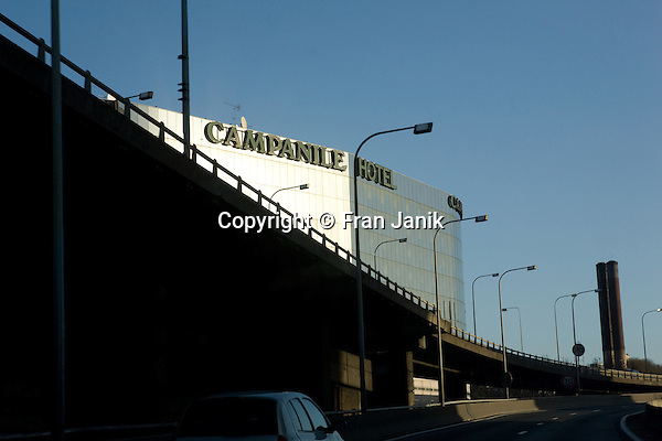 A View of the Campanile Hotel in Paris France. This photograph was taken from a moving car as it passed on the highway.