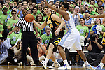 03 December 2014: Iowa's Adam Woodbury (34) and North Carolina's Kennedy Meeks (3). The University of North Carolina Tar Heels played the University of Iowa Hawkeyes in an NCAA Division I Men's basketball game at the Dean E. Smith Center in Chapel Hill, North Carolina. Iowa won the game 60-55.