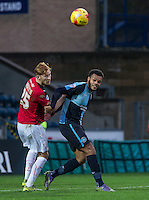 Aaron Amadi-Holloway of Wycombe Wanderers holds off Josh Yorwerth of Crawley Town during the Sky Bet League 2 match between Wycombe Wanderers and Crawley Town at Adams Park, High Wycombe, England on 28 December 2015. Photo by Andy Rowland / PRiME Media Images