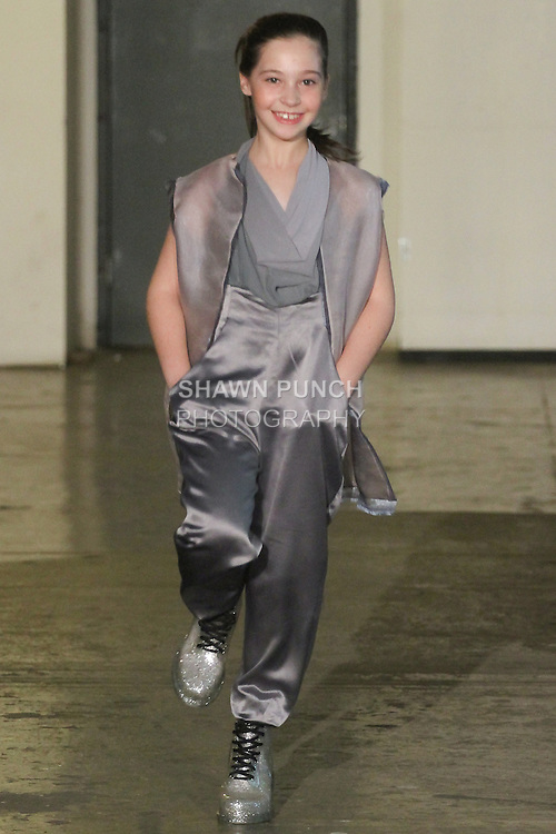Model walks runway in an outfit from the Jenny V Fashion Spring 2016 collection by Jenny Polozov, during Fashion Week Brooklyn Spring Summer 2016.