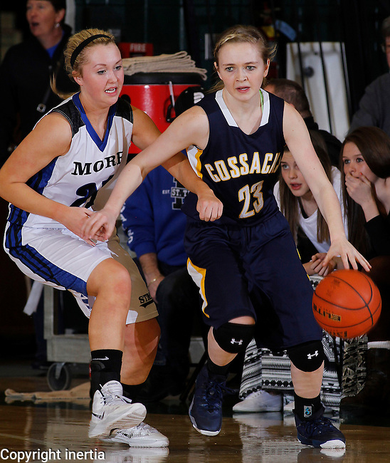 SPEARFISH, S.D. -- March 14, 2014 -- Carley Peterson #23 of Sioux Valley gets pressure from Madison Kirsch #2 of St. Thomas More during their semifinal game at the 2014 South Dakota State A Girls Basketball Tournament at the Donald E. Young Center in Spearfish, S.D. Friday. (Photo by Dick Carlson/Inertia)