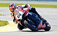 Shane Narbonne (64) is shown in action during the AMA SuperBike motorcycle race at Daytona International Speedway, Daytona Beach, FL, March 2011.(Photo by Brian Cleary/www.bcpix.com)