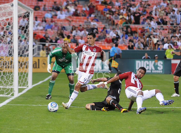 DC United forward Santino Quaranta (25) gets taken down in the area by Chivas USA defender Michael Umana (4)  DC United defeated Chivas USA 3-2 at RFK Stadium, Saturday May 29, 2010.