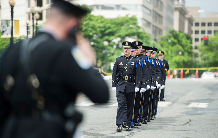 WASHINGTON, DC - MAY 11: U.S. Capitol Police honor guard members march into position for the Washington Area Law Enforcement Memorial Service outside of DC Police headquarters on Monday May 11, 2015. The event held by the Fraternal Order of Police Auxiliary DC Lodge honored deceased local law enforcement officers, including U.S. Capitol Police Sgt. Clinton J Holz. (Photo By Bill Clark/CQ Roll Call)