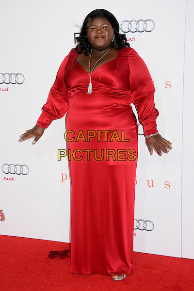 "GABOUREY ""GABBY"" SIDIBE.2009 AFI Film Festival Premiere of ""Precious"" held at Grauman's Chinese Theatre, Hollywood, California, USA,.1st November 2009..full length red dress long maxi sleeved sleeves silver necklace .CAP/ADM/BP.©Byron Purvis/Admedia/Capital Pictures"