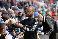 """Wednesday, 23 April 2014<br /> Pictured: Ashley """"Jazz"""" Richards signing autographs for supporters.<br /> Re: Swansea City FC are holding an open training session for their supporters at the Liberty Stadium, south Wales,"""