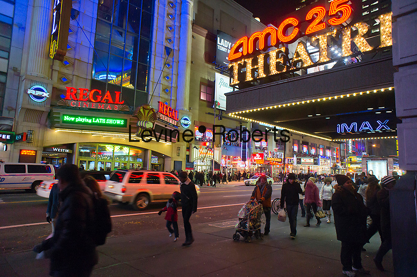 The AMC 25 and Regal Cinemas on 42nd Street in Times Square in New York are seen on Thursday, December 29, 2011. Revenue for movie theaters declined in 2011 compared to 2010. A lackluster season and a shift to digital home distribution are cited as reasons.  (© Richard B. Levine)