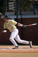 Second baseman Dustin Hood (21) of the Wake Forest Demon Deacons follows through on his swing versus the Clemson Tigers during the second game of a double header at Gene Hooks Stadium in Winston-Salem, NC, Sunday, March 9, 2008.