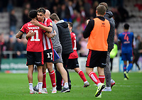 Lincoln City's Bruno Andrade, left, and Lincoln City's Tyler Walker celebrate at the end of the game<br /> <br /> Photographer Chris Vaughan/CameraSport<br /> <br /> The EFL Sky Bet League One - Lincoln City v Sunderland - Saturday 5th October 2019 - Sincil Bank - Lincoln<br /> <br /> World Copyright © 2019 CameraSport. All rights reserved. 43 Linden Ave. Countesthorpe. Leicester. England. LE8 5PG - Tel: +44 (0) 116 277 4147 - admin@camerasport.com - www.camerasport.com