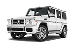 Stock pictures of low aggressive front three quarter view of 2016 Mercedes Benz G-Class AMG-G63 5 Door SUV Low Aggressive