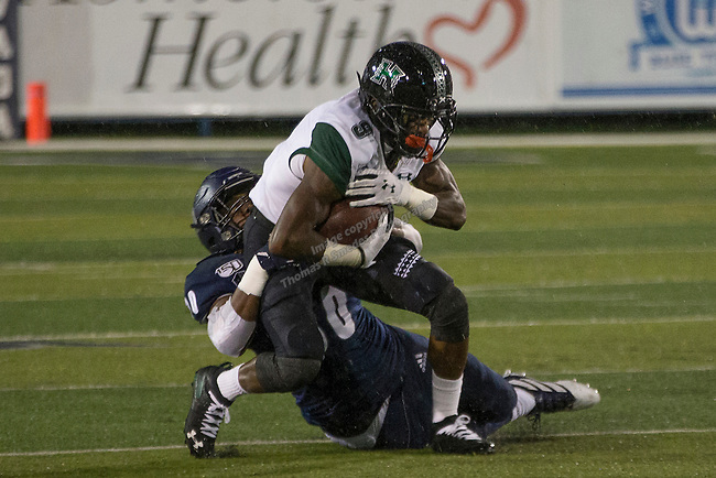 Hawaii wide receiver JoJo Ward (9) is tackled by Nevada linebacker Lawson Hall (30) in the first half of an NCAA college football game in Reno, Nev. Saturday, Sept. 28, 2019. (AP Photo/Tom R. Smedes)
