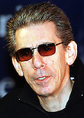 "Richard Belzer, who stars as Detective John Munch in various NBC Police dramas, appears at the John F. Kennedy Center for the Performing Arts in preparation for the ""Mark Twain Prize"" celebration in honor of Jonathan Winters in Washington, D.C. on October 20, 1999..Credit: Ron Sachs / CNP"