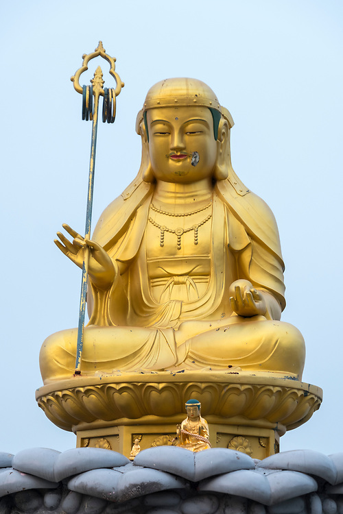 One of the golden buddhas at Haedong Yonggungsa Temple outside of Busan city