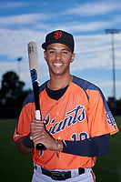 AZL Giants Orange infielder Edison Mora (18) poses for a photo before an Arizona League game against the AZL Giants Black on July 19, 2019 at the San Francisco Giants Baseball Complex in Scottsdale, Arizona. The AZL Giants Black defeated the AZL Giants Orange 8-5. (Zachary Lucy/Four Seam Images)