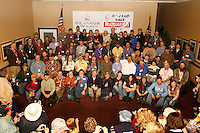The entire field of 67 mushers in this year's Iditarod race pose for a group photo during the mandatory musher's meeting at the Millenium hotel.   2009 Iditarod