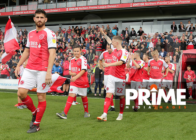Fleetwood Town players walk out at the start of the game  the Sky Bet League 1 match between Fleetwood Town and Rochdale at Highbury Stadium, Fleetwood, England on 18 August 2018. Photo by Stephen Gaunt / PRiME Media Images.
