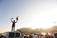 Jan 7, 2010; Pasadena, CA, USA; A fan of the Alabama Crimson Tide watches the Crimson Tide enter the stadium before the 2010 BCS national championship game against the Texas Longhorns at the Rose Bowl.  Mandatory Credit: Mark J. Rebilas-
