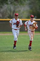 Canada Junior National Team outfielders Joshua Jones (25) and David Calabrese (7) jog to the dugout during an exhibition game against the Philadelphia Phillies on March 11, 2020 at Baseball City in St. Petersburg, Florida.  (Mike Janes/Four Seam Images)