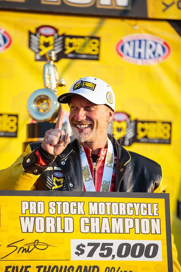Nov 11, 2018; Pomona, CA, USA; NHRA pro stock motorcycle rider Matt Smith celebrates after clinching the 2018 world championship during the Auto Club Finals at Auto Club Raceway. Mandatory Credit: Mark J. Rebilas-USA TODAY Sports