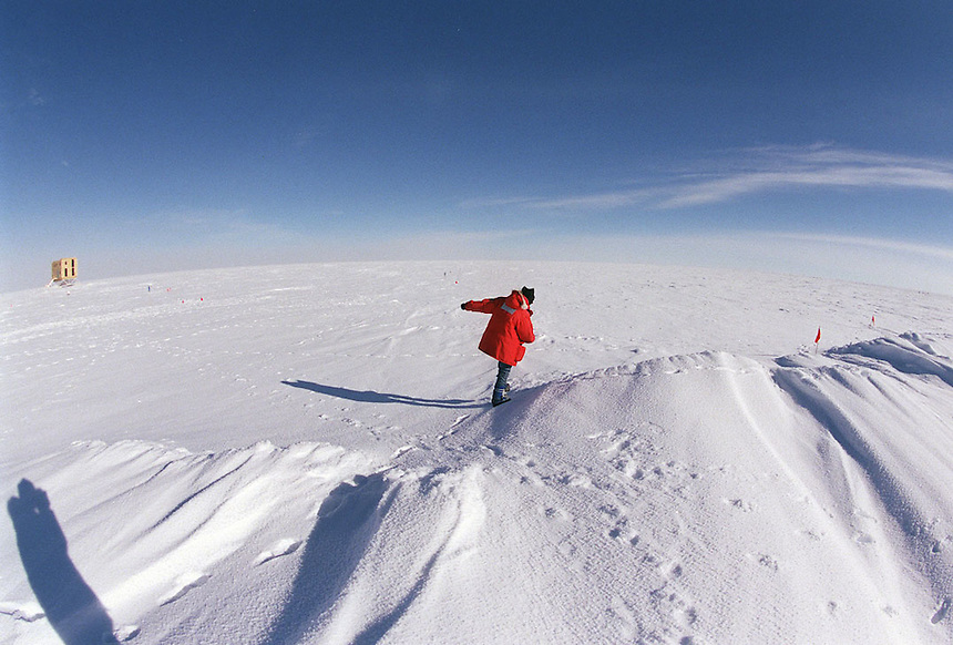 Katherine Rawlins, an astrophysicist, goes for a walk in the in the vast featureless plain at Amundsen-Scott South Pole Station in Antarctica. Ernie Mastroianni photo.