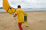 Surf Lifesaver guarding the beach. Most popular beaches in areas prone to marine stingers have stinger-resistant enclosures so beachgoers can enjoy swimming throughout the year. It is important to swim inside the enclosures as they are the only safe swimming zone on the beach. .Surf Lifesaving Queensland have an effective policy of dragging nets through the water to determine if stingers are lurking off the beach. If any are found, beachgoers are warned and lifeguard activity is heightened. In addition, if a stinger at a Queensland Beach stings anyone the beach enclosure is closed until a change of weather patterns can drive the stingers away from the coastline.