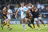 Ravai Fatiaki of Worcester Warriors is tackled by Billy Vunipola (right) and Christian Wade of London Wasps during the Aviva Premiership match between London Wasps and Worcester Warriors at Adams Park on Sunday 7th October 2012 (Photo by Rob Munro)