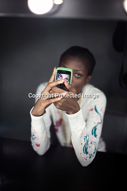 JOHANNESBURG, SOUTH AFRICA - MARCH 27: Nigerian model Tarmar Awobuto waits for make-up backstage before a fashion show at the South African fashion week on March 27, 2010, Turbine Hall in central Johannesburg, South Africa. Buyers and celebrities watched the three day fashion week, a biannual event. (Photo by Per-Anders Pettersson)