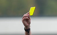 A Yellow card is shown during the Sky Bet League 2 match between Wycombe Wanderers and Northampton Town at Adams Park, High Wycombe, England on 3 October 2015. Photo by Andy Rowland.
