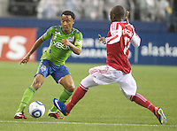Seattle Sounders FC midfielder James Riley, left, changes direction against Portland Timbers midfielder Kalif Alhassan during play at Qwest Field in Seattle Saturday May 14, 2011. The game ended 1-1 draw.