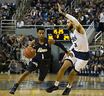 Akron guard  Loren Cristian Jackson (1) drives past Nevada's forward Cody Martin (11) in the second half of an NCAA college basketball game in Reno, Nev., Saturday, Dec. 22, 2018. (AP Photo/Tom R. Smedes)