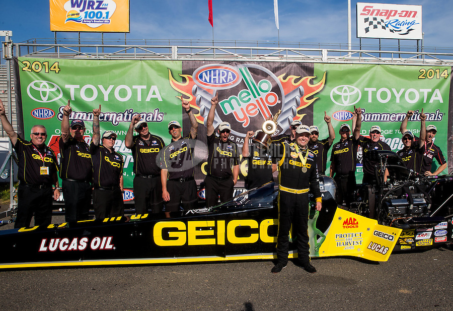 Jun. 1, 2014; Englishtown, NJ, USA; NHRA top fuel driver Richie Crampton celebrates with his crew after winning the Summernationals at Raceway Park. Mandatory Credit: Mark J. Rebilas-