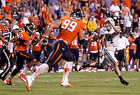 Brigham Young quarterback Taysom Hill (4) is pressured by Virginia defensive tackle Brent Urban (99) and Virginia defensive end Eli Harold (7) during the second half of the game in Charlottesville, Va. Virginia defeated Brigham Young 19-16. Photo/Andrew Shurtleff