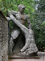 Bomarzo, Viterbo - Parco dei Mostri o Sacro Bosco, complesso monumentale realizzato nel 1547con grandi sculture di figure mitologiche del genere grotesque. Ercole e Caco<br /> Bomarzo, Viterbo - Monster Park or Sacro Bosco, a monumental complex built in 1547 with large sculptures of mythological figures such grotesque. Hercules and Cacus