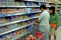 Various Biscuits are on sale in a Carrefour supermarket in Beijing, China. Major international chains like Carrefour and Walmart Stores have expanded aggressively in China. Local Chinese retailers have loudly protested this and lobbied heavily for protection from the new competition in price and service that these major retailers have set off..23 Jul 2006