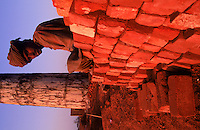 Brick Factory.Just outside the Harappa site they are making bricks the same way the ancient harappans did.....burying clay bricks and using rice husks for fuel to fire the bricks.  This saved the ancient Harappa site.  Scavenging of bricks stopped when the factories moved in. 4,800 years ago, at the same time as the early civilizations of Mesopotamia and Egypt, great cities arose along the flood plains of the Indus and Saraswati (Ghaggar-Hakra) rivers.  Developments at Harappa have pushed the dates back 200 years for this civilization, proving once and for all, that this civilization was not just an offshoot of Mesopotamia..They were a highly organized and very successful civilization.  They built some of the world's first planned cities, created one of the world's first written languages and thrived in an area twice as large as Egypt or Mesopotamia for 900 years (1500 settlements spread over 280,000 square miles on the subcontinent)..There are three major communities--Harappa, Mohenjo Daro, and Dholavira. The town of Harappa flourished during this period because of it's location at the convergence of several trade routes that spanned a 1040 KM swath from the northern mountains to the coast.