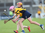 Emily Geary of Clonlara in action against Emma Lynch of Inagh/Cloonanaha  during their Schools Division 1 final at Cusack Park. Photograph by John Kelly