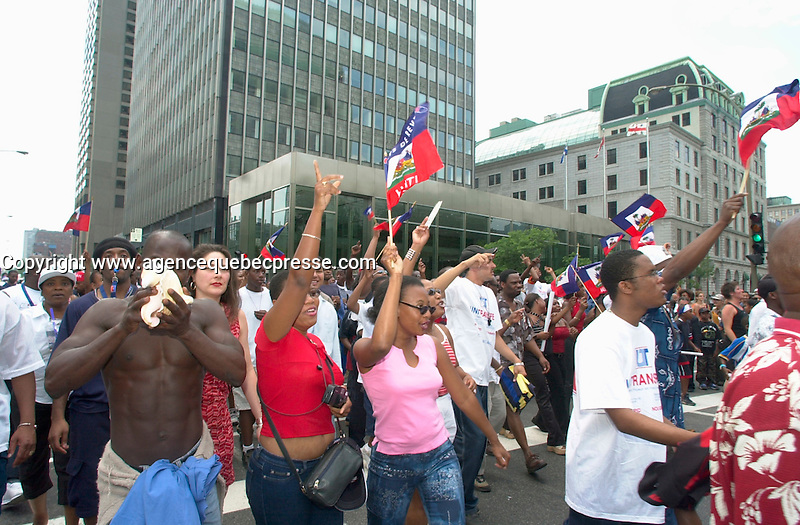 June 4 2002, Montreal, Quebec, Canada<br /> <br /> Members of the Haitian community take part in the Carifiesta Parade June 6, 2002 in Montreal, Canada.<br /> <br /> Mandatory Credit: Photo by Pierre Roussel- Images Distribution. (&copy;) Copyright 2002 by Pierre Roussel <br /> <br /> NOTE :<br />  Nikon D-1 jpeg opened with Qimage icc profile, saved in Adobe 1998 RGB.<br /> Uncompressed,uncropped, original size file available on request.