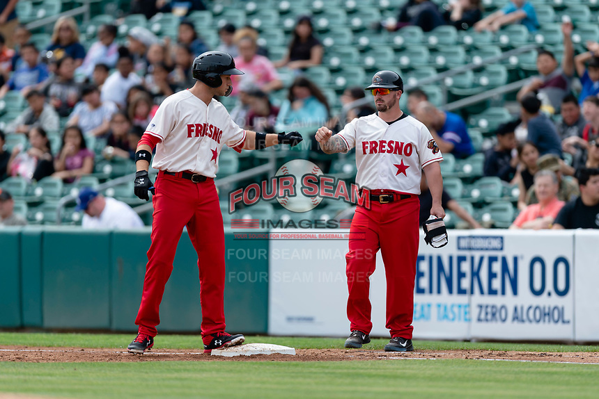 Fresno Grizzlies shortstop Carter Kieboom (8) stands on first base after hitting a single during a game against the Reno Aces at Chukchansi Park on April 8, 2019 in Fresno, California. Fresno defeated Reno 7-6. (Zachary Lucy/Four Seam Images)