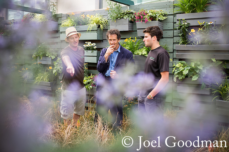 © Joel Goodman - 07973 332324 . 3 August 2013 . Cathedral Street , Manchester , UK . Monty Don (centre) meets people who have built gardens for the festival . Dig the City urban gardening festival . Photo credit : Joel Goodman