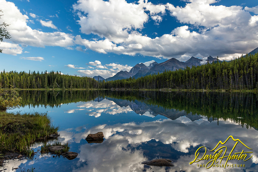 A calm moment on Herbert Lake in Banff National Park. The mountains in the distance are the ones that tower above Lake Louise and Moraine Lake.  Herbert Lakes place in the center of the Bow River Valley makes it's mountains a bit more diminutive; however, despite its distance from it's mountains, Herbert Lake still has it's moments.