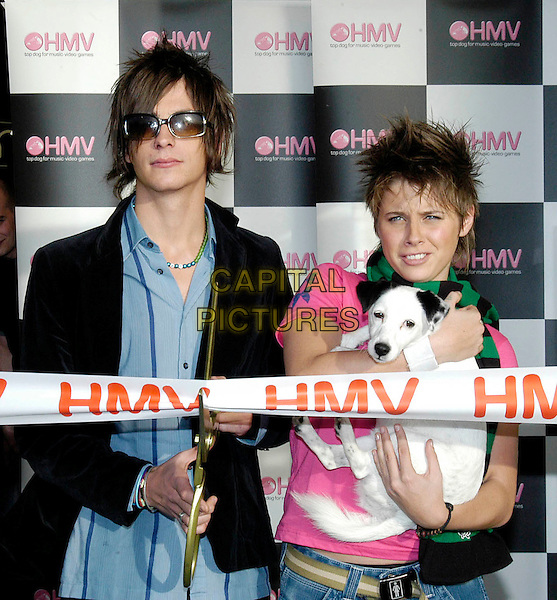 PETER & ALEX PARKS .Fame Academy winner & runner-up.HMV Store opening, Greenwich.dog animal, cutting ribbon.www.capitalpictures.com.sales@capitalpictures.com.©Capital Pictures