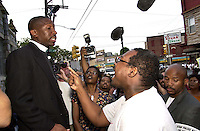 A protestor, right, yells at a local minister, after hundreds turned out at a protest of the July 12 beating of Thomas Jones by city police officers attempting to arrest the carjacking suspect, when he was denied access, along with others, becasue of lack of space in the church Sunday, July 23, 2000, in Philadelphia. The beating incident was videotaped by a local television station helicopter, and broadcast around the world, shedding a bad light on the city of Philadelphia two weeks before the Republican National Convention. MANDATORY CREDIT: (Photo by William Thomas Cain/Photojournalist.cc)