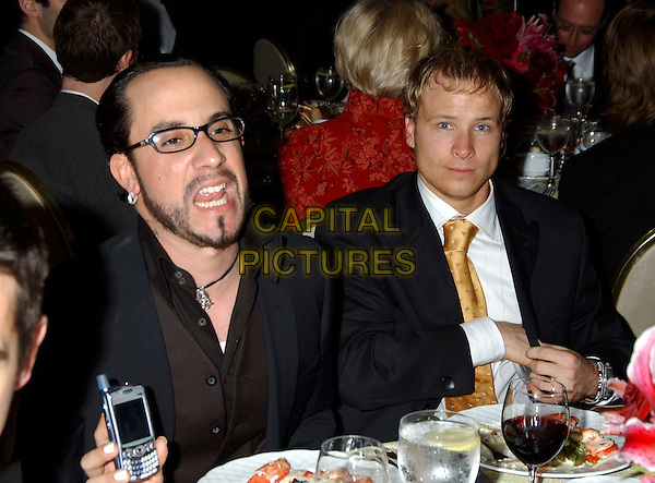 NICK CARTER.2005 Clive Davis Annual Grammy Party Cocktail Reception held at the Beverly Hills Hotel, Beverly Hills, California, USA,.12th February 2005..Half length sitting at table funny.Ref: ADM.www.capitalpictures.com.sales@capitalpictures.com.©LFarr/AdMedia/Capital Pictures .