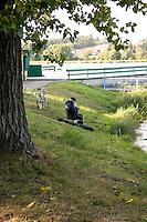 Fisherman with bicycle at city park. Rawa Mazowiecka Central Poland