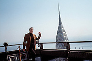 "Manhattan, New York City - May 1969. Picture of Yves Montand taken on top of the Pan Am building. Yves Montand is playing a role on top of the building for the film ""On a Clear Day You Can See Forever"" directed by Vincent Minnelli and co-starring Barbara Streisand. Yves Montand (October 13, 1921 - November 9, 1991) was an Italian-born French actor and singer, who was discovered by renown singer ´Edith Piaf, and is most known for his performance in the movie Jean de Florette."