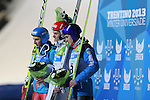 From left Krzysztof Biegun (POL), Finland's Sami Niemi and Russia's  Mikhail Maksimochkin at the podium of the Normal Hill Ski Jumping event as part of the Winter Universiade Trentino 2013 on 14/12/2013 in Predazzo, Italy.<br /> <br /> &copy; Pierre Teyssot - www.pierreteyssot.com