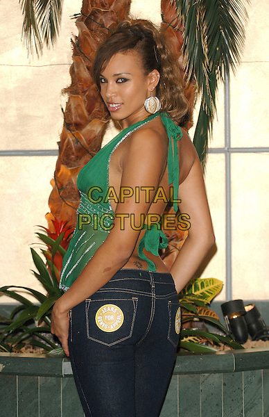 JAVINE HYLTON.Rear of the Year Award recognising male and female celebrities with the shapeliest bums, Carlton Tower Hotel, Knightsbridge, London..September 14th, 2006.Ref: BEL.half length green top back behind looking over shoulder backless halterneck.www.capitalpictures.com.sales@capitalpictures.com.©Tom Belcher/Capital Pictures.