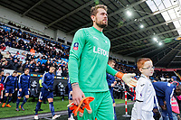 Kristoffer Nordfeldt of Swansea with Swansea child mascot prior to kick off of the Fly Emirates FA Cup Quarter Final match between Swansea City and Tottenham Hotspur at the Liberty Stadium, Swansea, Wales, UK. Saturday 17 March 2018
